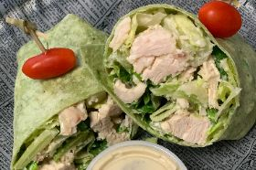 Hearts of Romaine, Shredded Parmesan Cheese, Roasted Chicken Breast tossed in our Signature Caesar Dressing and wrapped in a Spinach Wrap.