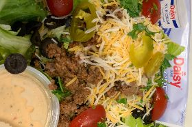Taco Beef over Romine, Grated Cheese, Avocado, Cherry Tomatoes, Olives, Cilantro, Jalapenos, Frito's and Sour Cream with our House Jalapeno Ranch.