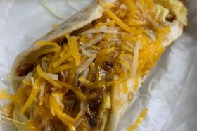 Flour Street Taco with Organic Eggs, Chorizo and Grated Cheese served with Salsa.